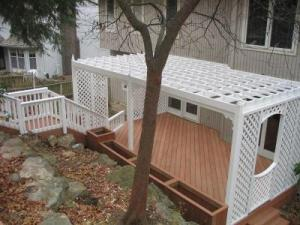 Kansas City WeatherBest Composite Deck with Painted Treated Wood Pergola with Custom Gate and Lattice