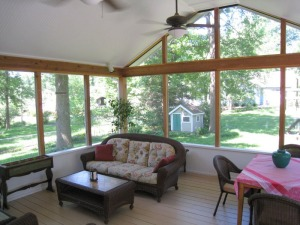 A large screened porch with open gable roof
