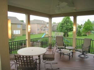 Lenexa Open porch with trimmed columns, lighting and Timbertech floor, Westbury Aluminum rail