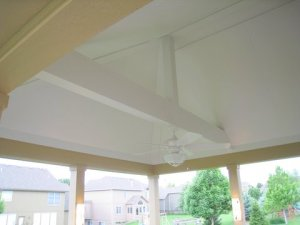 Screened porch with beadboard ceiling and exposted rafters