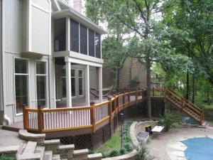 Kansas City AZEK deck in Acacia color with Deckorator balusters and cedar railing