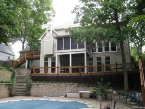 Large curved Kansas City AZEK deck with small BBQ deck near 2nd story kitchen