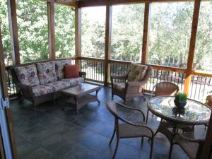 Large screened in porch Overland Park tile floor