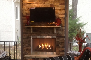 KC screened porch with outdoor fireplace