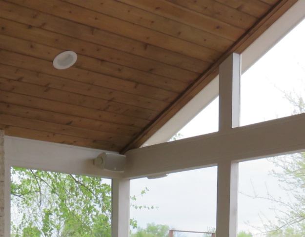 The open gable roof creates a bright and airy feel in the room. Also notice the electrical amenities of lighting and installed speakers.